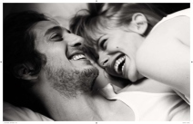 in-bed-couple-laughing-love
